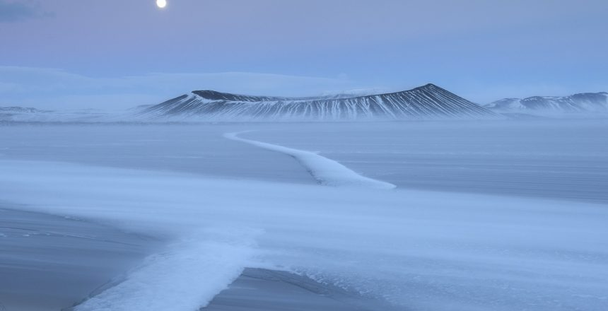 The crater of Hverfjall with the frozen Myvatn in the foreground. Full Moon. Iceland.